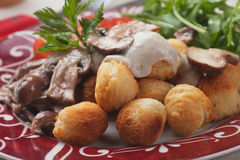 Roasted potato croquettes with portabello mushrooms Royalty Free Stock Images
