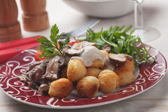 Roasted potato cruquettes and mushrooms Stock Photos