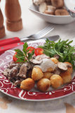 Roasted potato cruquettes and mushrooms Royalty Free Stock Images