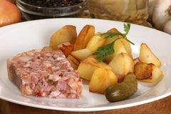 Roasted potato with cured meat Stock Images