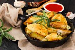 Roasted potato with fresh rosemary Stock Photography