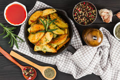 Roasted potato with fresh rosemary in cast-iron pan Royalty Free Stock Photography