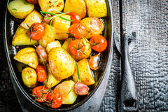 Roasted potato with fresh tomato and garlic Stock Image