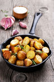 Roasted potato in frying pan Royalty Free Stock Images