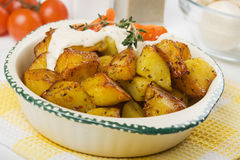 Roasted potato with herbs and cream Stock Photos