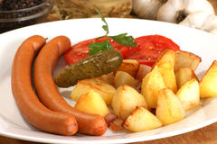 Roasted potato with home made sausages Stock Photography