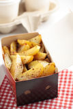 Roasted potato in a paper box Royalty Free Stock Image