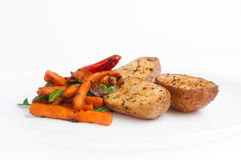 Roasted potato with spicies, carrot and hot pepper Stock Photo