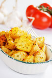 Roasted potato with tomato and garlic Royalty Free Stock Images