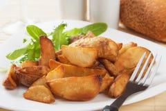 Roasted potato wedges Royalty Free Stock Photos