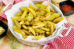Roasted potato wedges with herbs Royalty Free Stock Photos