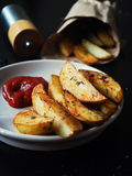 Roasted potato wedges Royalty Free Stock Photo