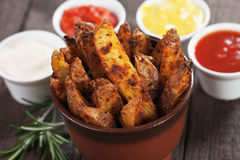 Roasted potato wedges Stock Photography