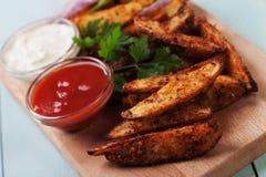 Roasted potato wedges Stock Photo