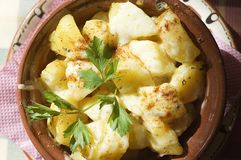 Roasted potatoes. Bulgarian kitchen: roasted potatoes in national dish Royalty Free Stock Photo