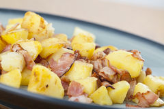 Roasted potatoes with bacon Stock Image