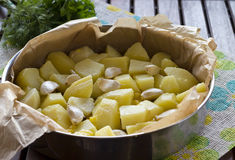 Roasted potatoes with garlic. Raw potatoes with garlic ready to be baked Royalty Free Stock Photo