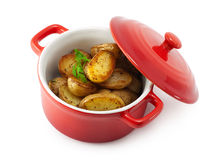Roasted potatoes and herbs in the pan. See my other works in portfolio royalty free stock image