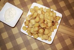 Roasted potatoes and mayo. Served for lunch Stock Images
