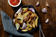 Roasted potatoes in a pan on the table Stock Images