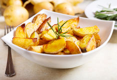 Roasted potatoes with rosemary Royalty Free Stock Photos