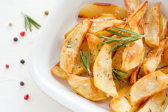 Roasted potatoes with rosemary on white background Stock Photo