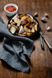 Roasted potatoes with spices in a pan garlic Stock Photography