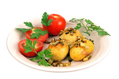 Roasted potatoes with tomatoes. Stock Photo