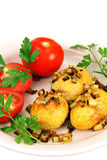Roasted potatoes with tomatoes. Royalty Free Stock Image