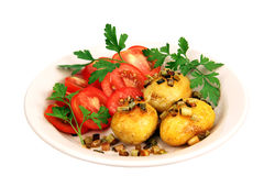 Roasted potatoes with tomatoes. Royalty Free Stock Photography