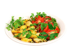 Roasted potatoes with tomatoes. Stock Photography
