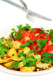 Roasted potatoes with tomatoes. Royalty Free Stock Photo