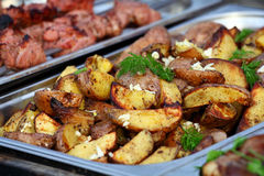 Roasted potatoes on tray Stock Photo