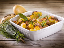 Roasted potatoes with tuna. And rosemary Royalty Free Stock Photo