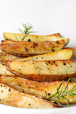 Roasted potatoes vertical. Shot of roasted potatoes vertical Royalty Free Stock Images