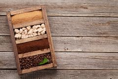 Roasted and powder coffee, brown sugar. Roasted beans, powder coffee and brown sugar in wooden box. Top view with space for your text royalty free stock photography