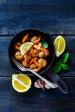 Roasted prawns in pan Stock Photos