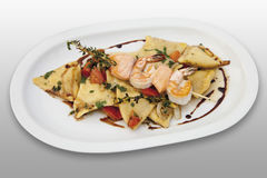 Roasted prawns and salmon with origan and ravioli in plate Royalty Free Stock Photo