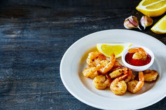 Roasted prawns with sauce Royalty Free Stock Images