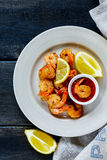 Roasted prawns with sauce Royalty Free Stock Image
