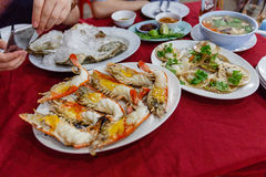 Roasted Prawns and Scallop with Seafood Hot and Sour Soup Royalty Free Stock Images