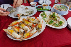 Roasted Prawns and Scallop with Seafood Hot and Sour Soup Stock Photo