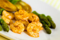 Roasted Prawns With Green Asparagus And Potato Stock Photos