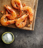 Roasted prawns on wooden cutting board Stock Photos