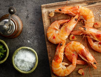 Roasted prawns on wooden cutting board Stock Image