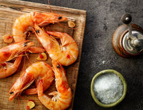 Roasted prawns on wooden cutting board. Top view stock photo