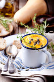 Roasted pumpkin and carrot soup with cream . stock images