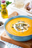 Roasted pumpkin and carrot soup with cream . stock photos