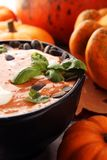 Roasted pumpkin and carrot soup with cream and pumpkin seeds on royalty free stock images