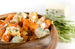 Roasted pumpkin with cheese, cashew and rosmary Stock Image